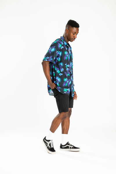 men's short sleeve party shirt by Poolside Party Shirts with blue, green and black tropical leaf print full length view