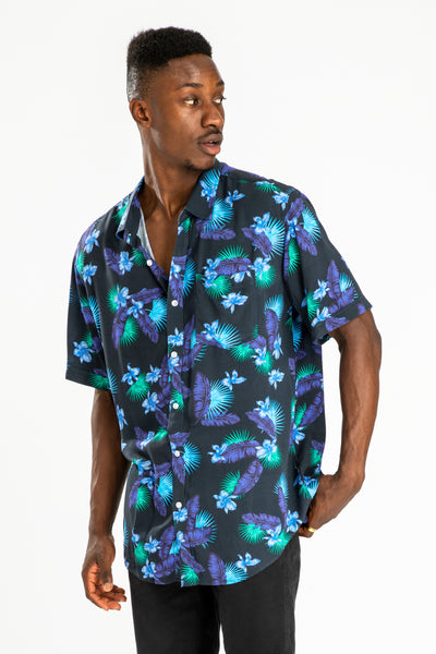 men's short sleeve party shirt by Poolside Party Shirts with blue, green and black tropical leaf print front view 02