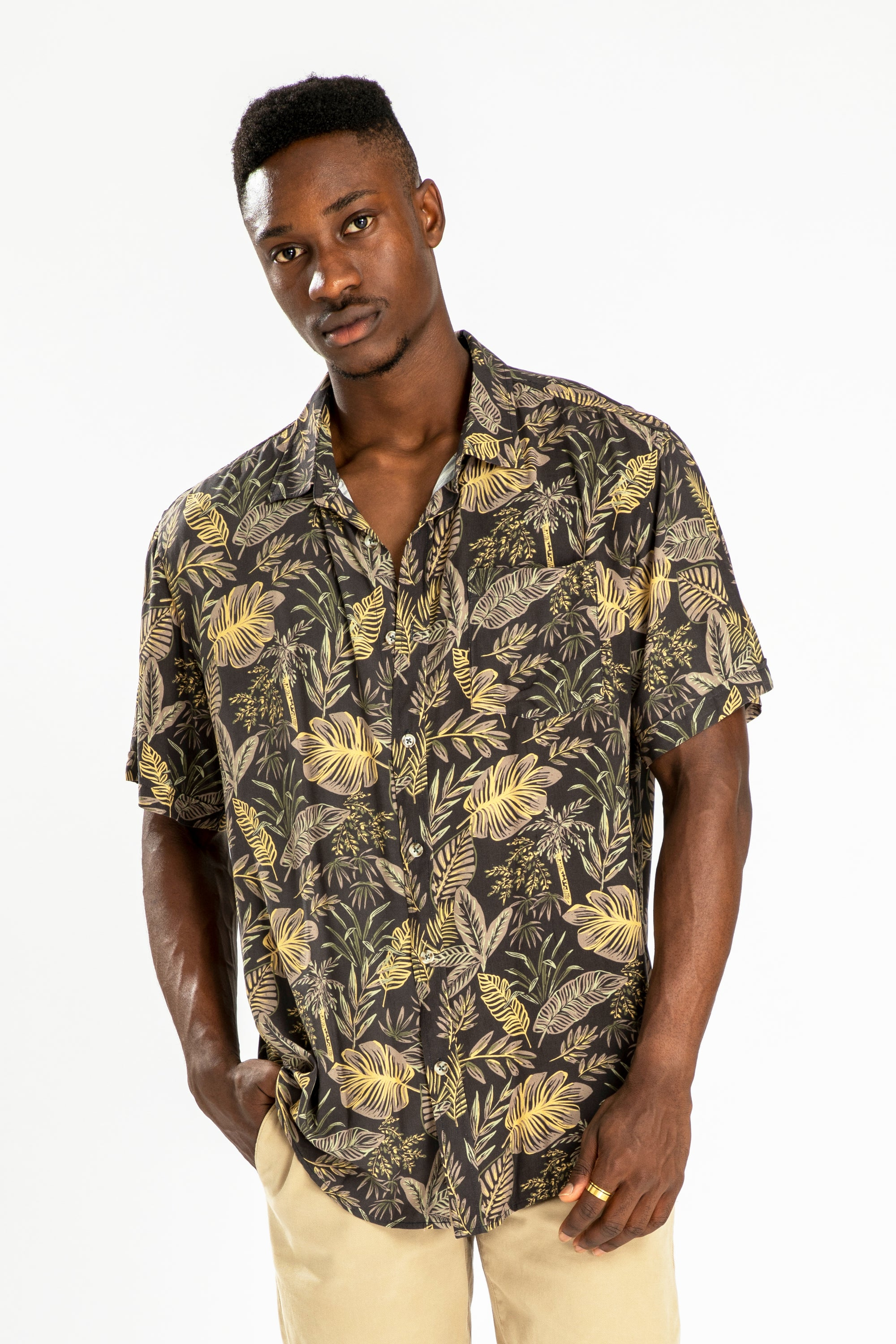 men's short sleeve party shirt by Poolside Party Shirts with tropical leaf textile print front view