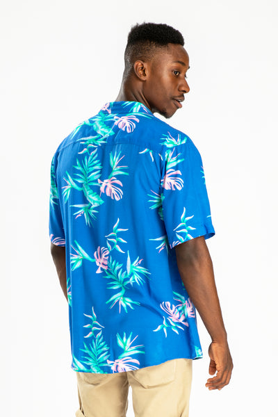 men's short sleeve party shirt by Poolside Party Shirts with blue tropical textile print back view