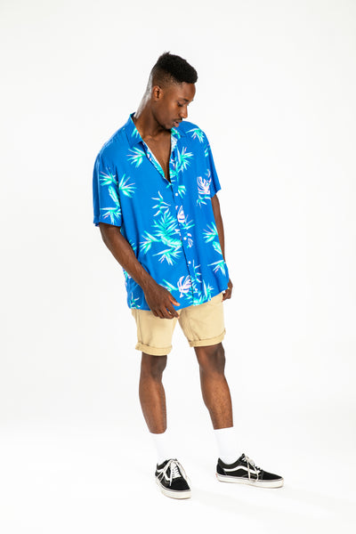 men's short sleeve party shirt by Poolside Party Shirts with blue tropical textile print full length view
