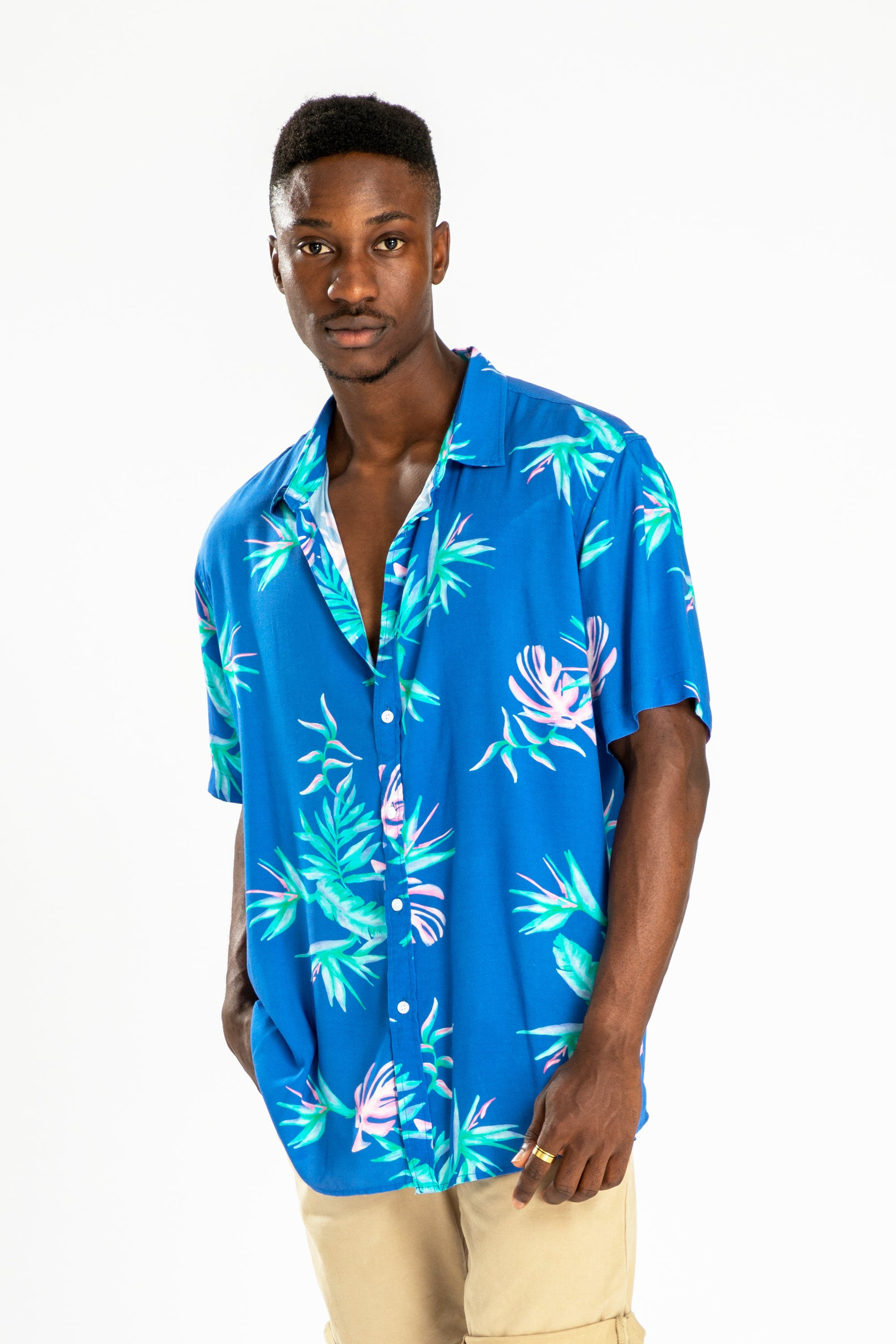 men's short sleeve party shirt by Poolside Party Shirts with blue tropical textile print front view