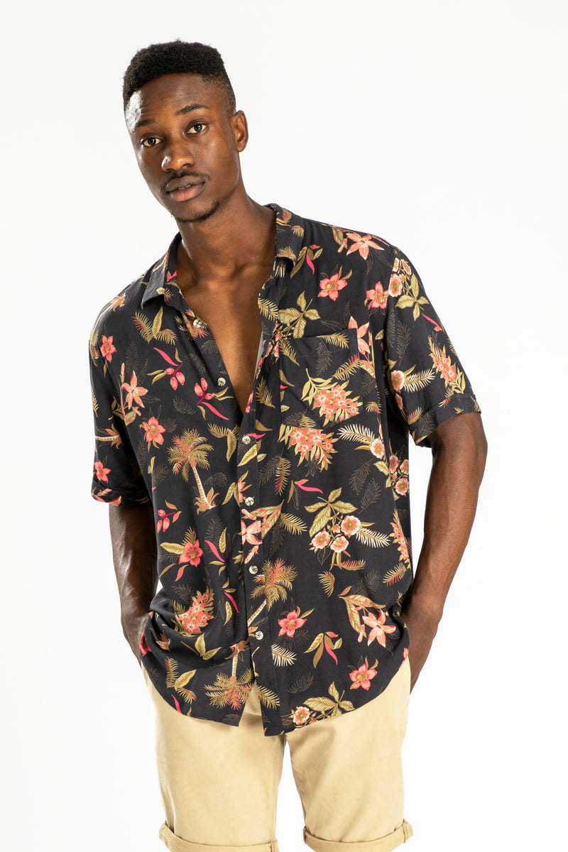 men's short sleeve party shirt by Poolside Party Shirts with dark tropical textile print front view