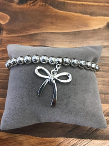 Silver Coloured Bracelet with Bow Charm