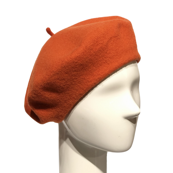 Le Beret Francais in Orange on a Brisbane Hatters mannequin head