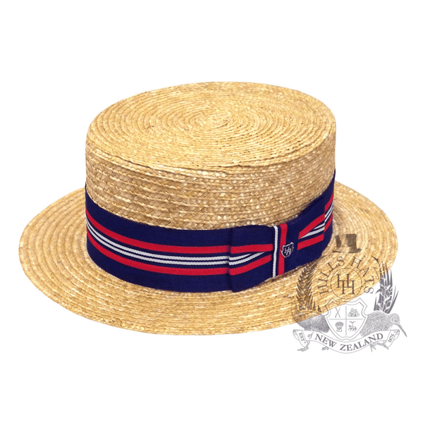 angle view Hills Hats Straw Boater hat with red and navy ribbon