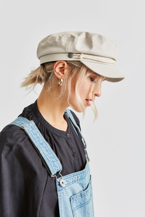 Woman wearing Dove coloured Brixton Fiddler cap, side on