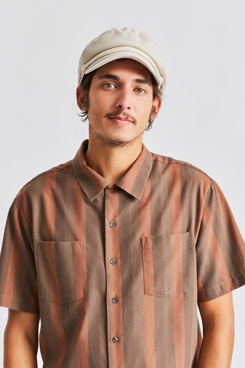 Man wearing Dove coloured Brixton Fiddler cap, front on