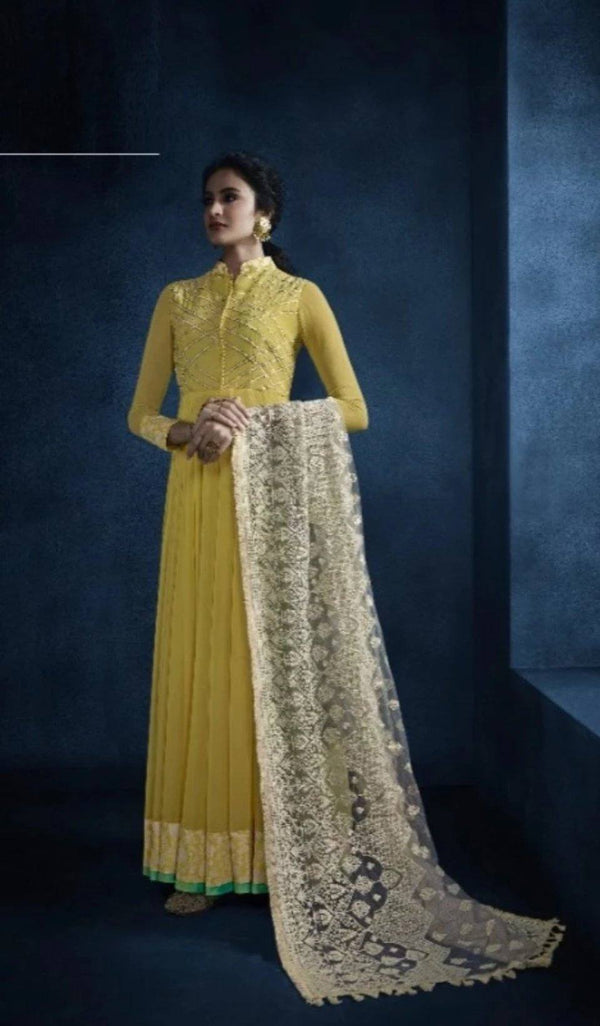 Cherubic Yellow Colored Georgette Kurti With Net Dupatta