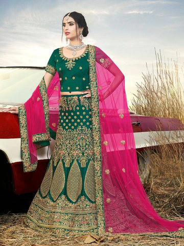 Adorning Green Colour Satin Silk Lehenga Choli With Heavy Stone Embroidery And Net Dupatta