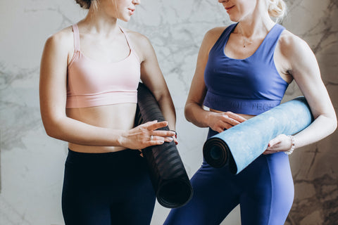 two ladies are wearing yoga clothes