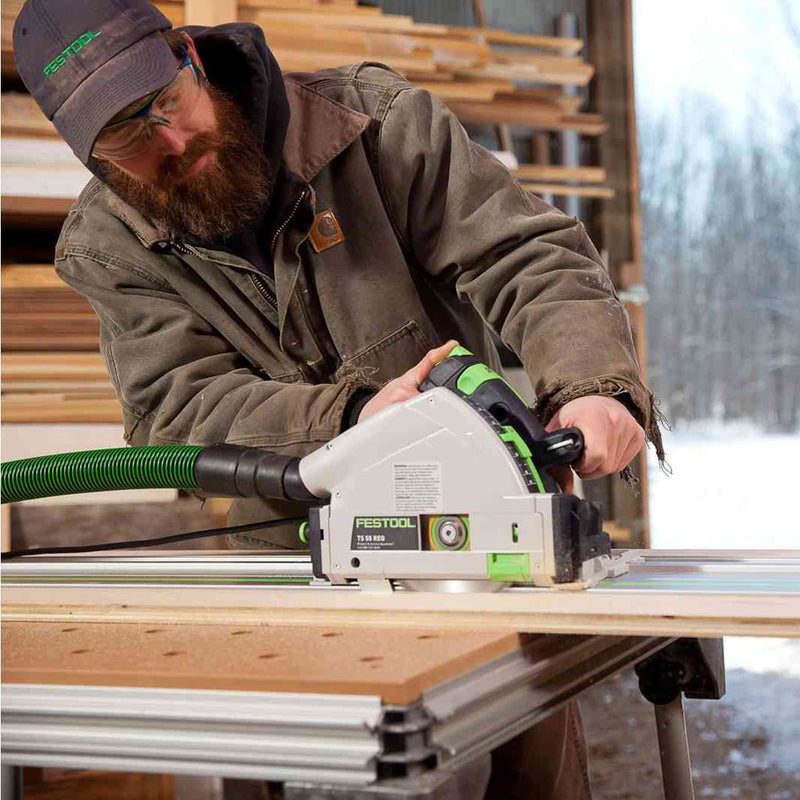 A woodworker uses his Festool TS 55 REQ plunge-cut circular saw on a guide rail to make a long rip cut.