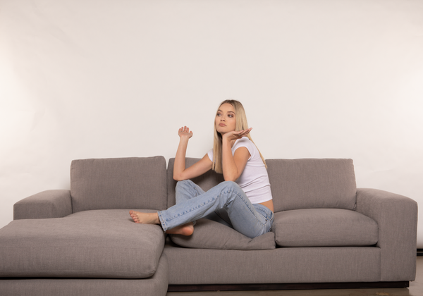 woman sitting in a sectional sofa