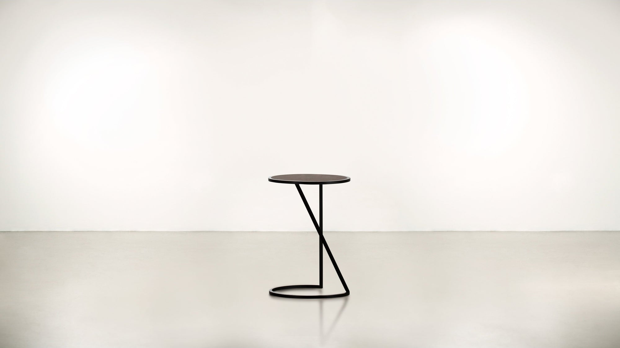 The Free Spirit Side Table Black / Chocolate Whom. Home