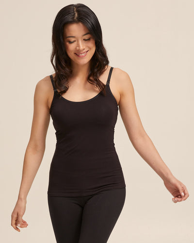 Woman wearing a black Peachymama nursing cami top