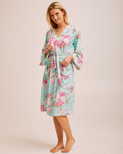 Woman wearing a mint Peachymama layering robe