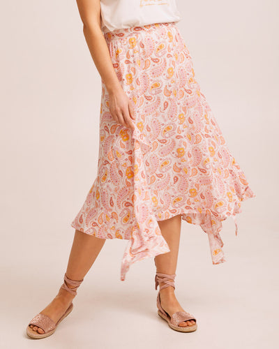 Woman wearing a paisley Peachymama ruffle postpartum skirt