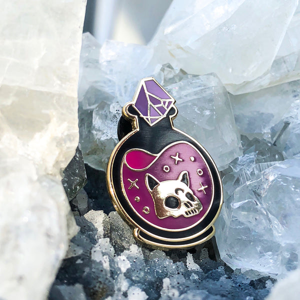 """9 lives elixir"" enamel pin"