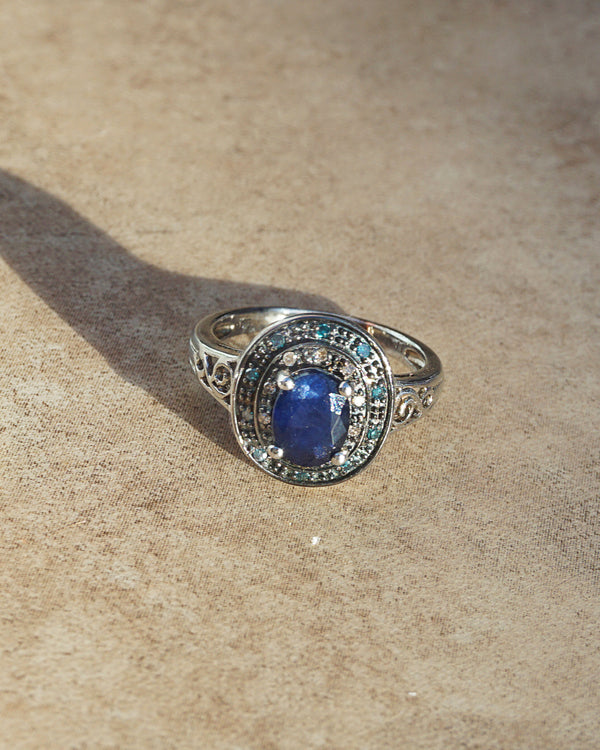 AA-Grade Blue Sapphire with Blue and Champagne Diamonds