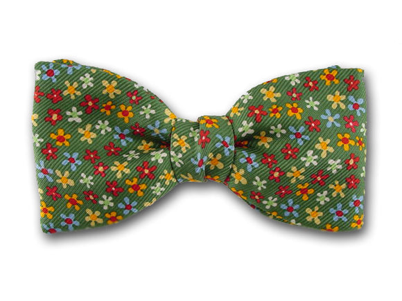 Smal lflower on green. Bow tie for baby, boy and youth.