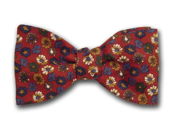 Boys silk bow tie. Flowers on red.