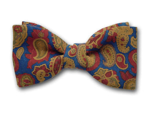 Brown, ochre, and green paisley on blue. Blue silk bow tie. Paisley bow ties.