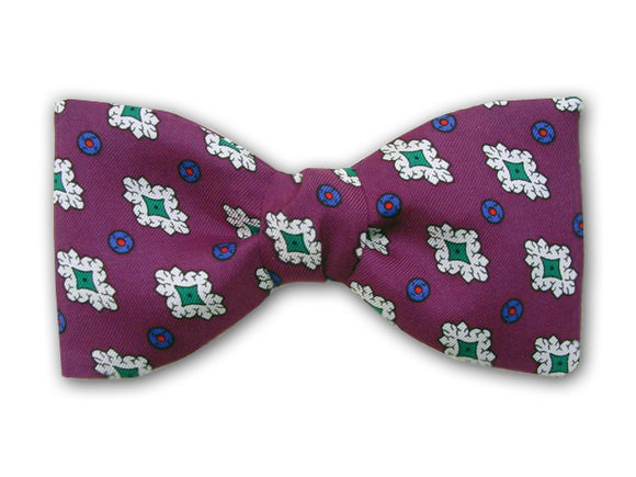 Purple bow tie with green, white, blue, and red. Men's accessory.