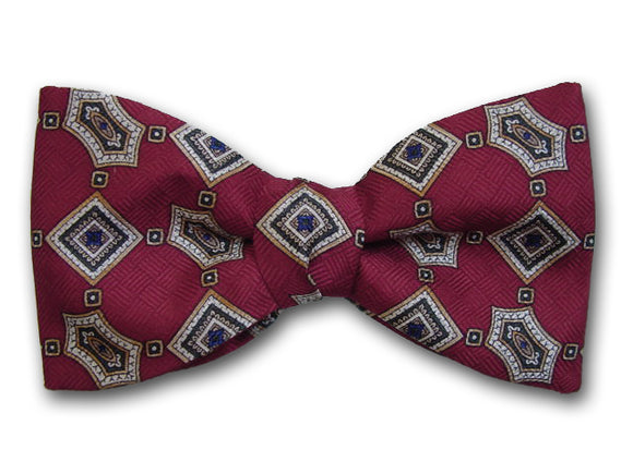 Burgundi pure silk bow tie. Geometric design.