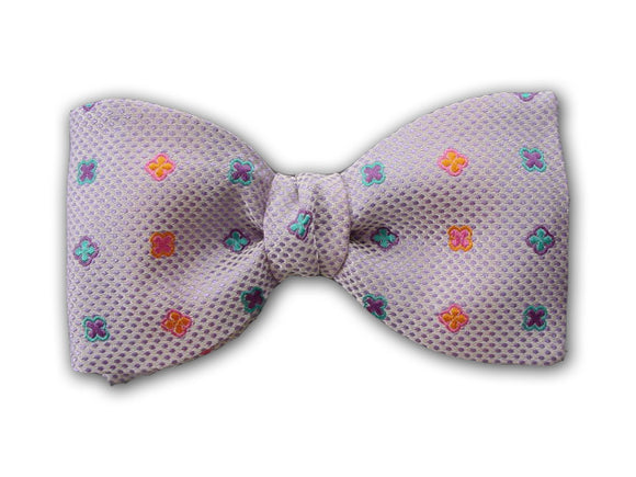 Pink, teal and purple geometric figures on lilac. Woven silk bow tie for men.