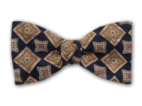 Gold square on navy. Fine silk bow tie for men.