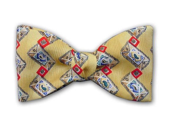 Red square on yellow. Silk bow tie for men.