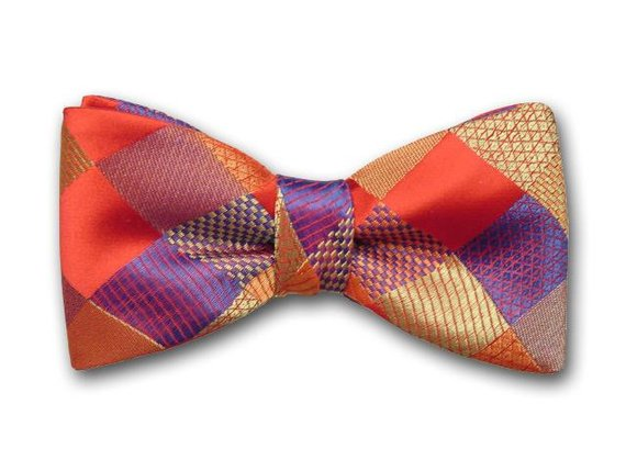 Luxurious men's bow tie. Red, gold, ochre and blue plaid bow tie.