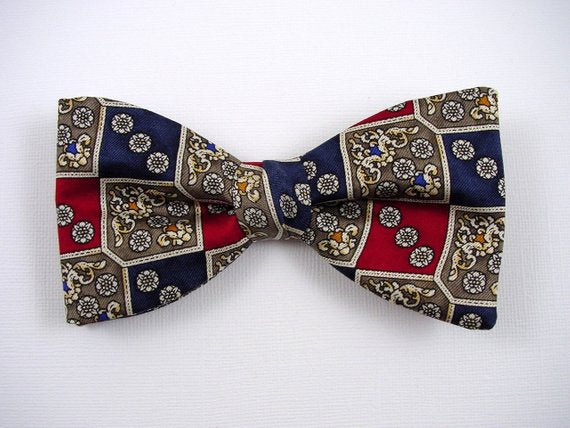 Grey small flower in red and navy squares. Men's silk bow tie.