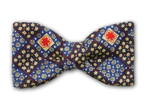 Plaid pure silk bow tie with navy, blue, yellow and red squares.