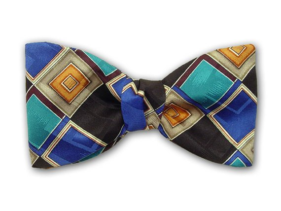 Plaid silk men's bowtie. Teal, royal blue, black, ochre, pale green and white squares.