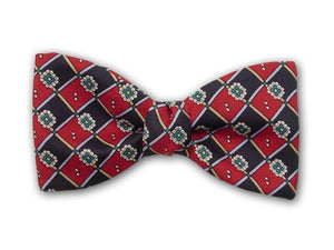 Silk men's bow tie. Green flowers and navy and red squares.