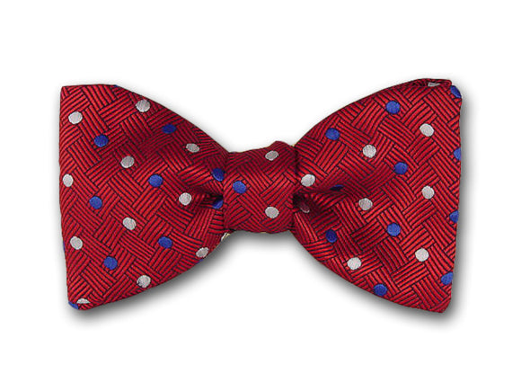 White and blue dots on red. Woven silk polka dot bowtie.