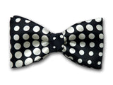 Formal black and white bow tie. White dots on black.