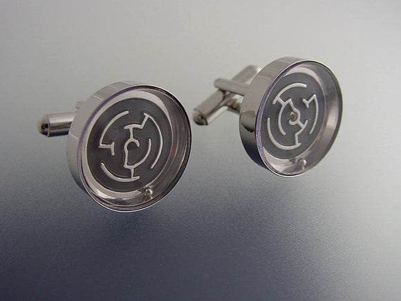 Black maze cufflinks in silver tone casing.