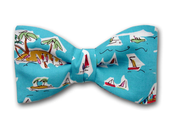 Blue Pictorial Bow Tie. Boats in Caribbean Sea. Palm Trees.