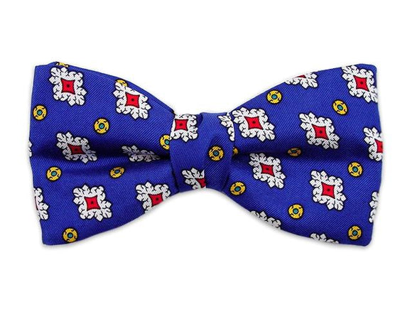 Royal blue bow tie. Small patterns white and red on blue. Self tie bow tie