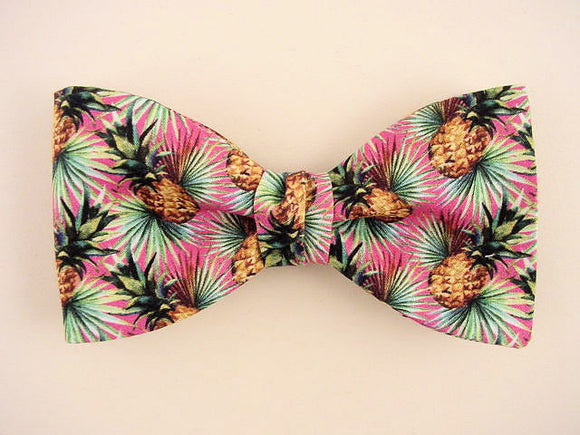 Hawaiian bow tie for men. Gold pineapple on pink.