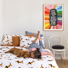 Sausage Dog Range by Castle. Styled Children's Bedroom with Sausage Dog and Girl. Sausage Dog Quilt styled with Butterscotch Linen Pillowcase and Sheets. Dusty Blue Euro. Rachel Castle Artwork