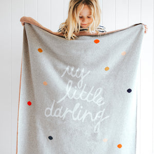 Small Darling Baby Throw. Blonde girl holding blanket