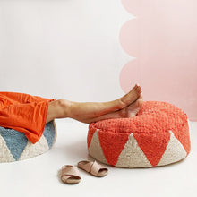 Watermelon Circus Floor Cushion. Person with feet up relaxing. Sandals on floor