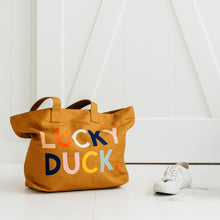 Lucky Duck Tote Bag by Castle in White Room Situ with Unworn Sneaker Beside