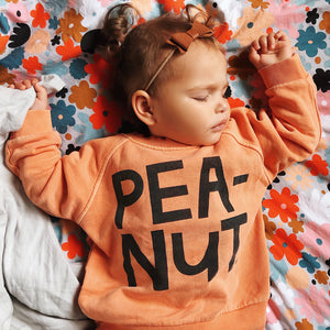 Baby Peanut Sweater by Castle. Little girl sleeping in Sweet Pea range by Castle