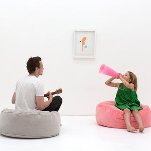 Ice Grey Velvet Floor Cushion by Castle. Baby Pink Velvet Floor Cushion. Made by Castle. Young boy and girl playing music