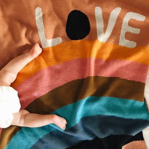 baby sleeping on love rainbow baby blanket by castle