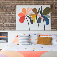 Rachel Castle Flower Painting by Castle. Multi Spot Quilt Styled with Knit Throw and Assortment of Castle Cushions
